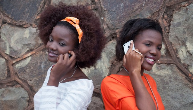 Two women talking on their cellphones