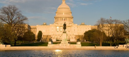 US Capitol Building and reflecting pool and sun
