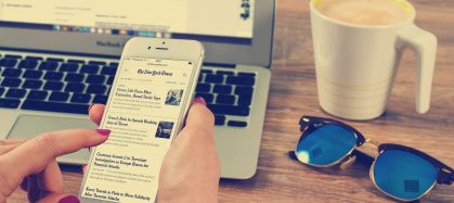 Woman's hands scrolling news on Iphone