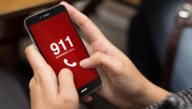 Girl using cell phone to call 911