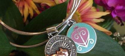 Carry light Alex and Ani bracelet and flower backdrop