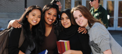 Group of diverse college students posing for photograph