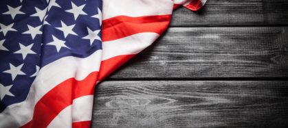 USA Flag on dark wood background