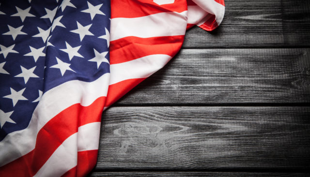 USA Flag on dark wood background