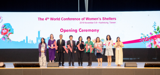 Kaofeng Lee joins President Tsai Ing-wen, Garden of Hope CEO, Chi Hui-Jung, and other members of the Global Network of Women's Shelters conference planning committee for a group photo during the opening ceremony.
